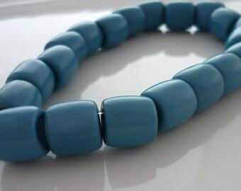 Vinatge pale petrol blue lucite barrel beads 9mm