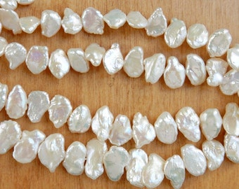 Beautiful Creamy White keishi middle , side-drilled baroque pearls. 12-16x8-11mm,