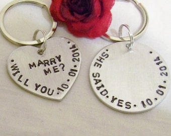 Wedding proposal engagement hand stamped key chains, heart says, will you marry me, circle says, she said yes, both with engagement date