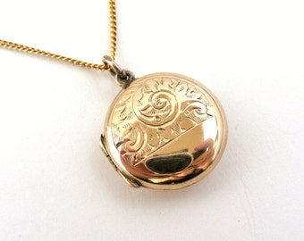 Vintage English round locket gold back and front on gold fill chain .
