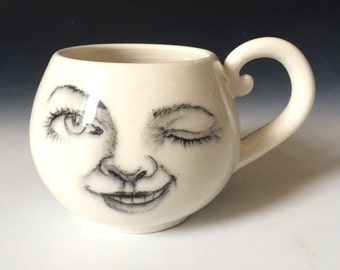 Winking Lady Moon Mug, Moon Coffee Cup that has a Hand Drawn face of the Moon