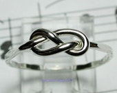 Handcrafted Sterling Silver Infinity Ring  . Just plain cute.