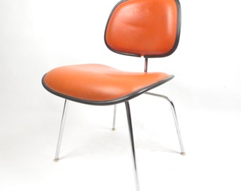 On Sale Herman Miller Eames bright orange DCM dining chair #1 of 2 available