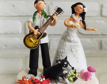 Lovely couple with playing guitar and dancing the Hula custom wedding cake topper