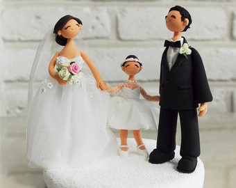 Happy couple with a daughter custom wedding cake topper