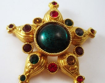 Star brooch- five pointed star pin with green center and rhinestones