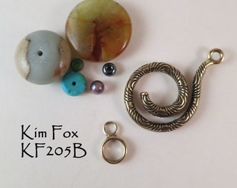 Chartres Spiral Clasp in golden bronze designed by Kim Fox