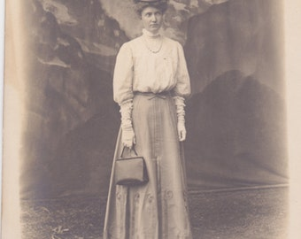 On my way - traveling woman- RPPC photo