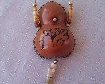Rust gourd wolf medicine bag necklace. 1900.