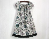 Girls boutique style peasant style dress. Lavender and Teal floral Paisley with black eyelet lace