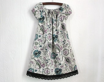 Sale. Girls boutique style peasant style dress in Size 6 Only. Lavender and Teal floral Paisley with black eyelet lace