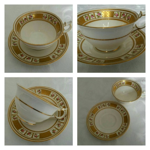 Two George Jones Tea Cups and Saucers; Featuring Hand Painted Cartouches Of Roses Surrounded With Raised Gold Beading circa 1920's-  DR