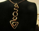 Large funky arrow pendant necklace abstract gold wire wrapped on brown leather cord