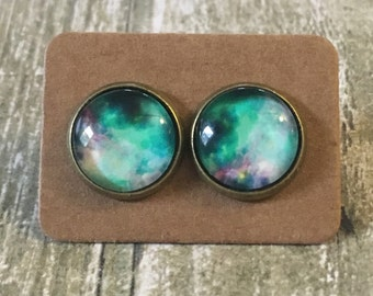 Gorgeous teal galaxy studs