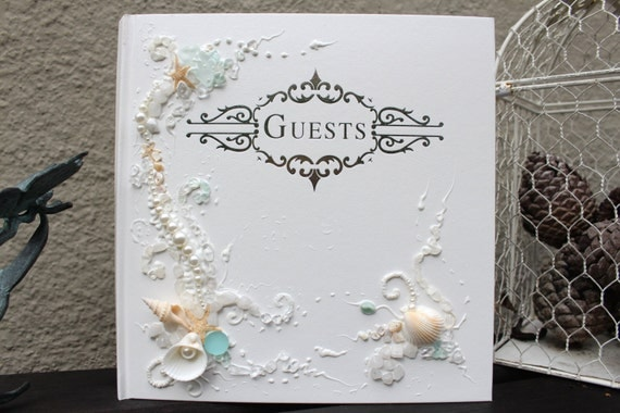 """Beach wedding guest book, hand decorated with sea shells, starfish, sea glass, beads and pearls, 11""""x 10"""" with a pen or 6""""x8.5"""""""