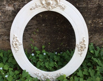A Large Antique Wooden Oval Frame That Is Chic And Fabulous