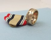 For the Iraq Veteran.  This is a Iraq Campaign medal turned into a size 11  ring.  A Unique gift to wear on those special occations