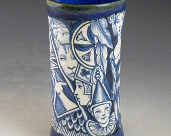Blue and white intricate one of a kind porcelain story vase or drinking glass