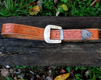 Outstanding, hand tooled, carved western belt, great deal if your name is KRISTI