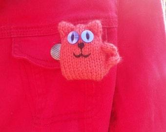 Dark orange Cat knitted brooch.