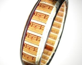 handmade resin filmstrip bracelet . vintage educational film about Farmlife . Life on the Farm . trotting horse