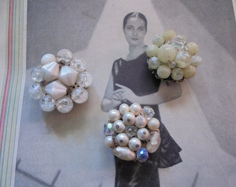 Repurposed earring magnets in shades of white