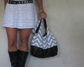 leather and chevron purse. large over the shoulder hobo bag with split fabric leather bottom style. Fall fashion trend.