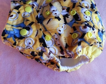 SassyCloth one size pocket diaper with minions packed cotton print. Made to order.