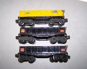 Three Piece Set of Lionel Prewar 2652 Tin Plate Gondolas With Postwar Trucks