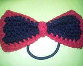 Crocheted bow ponytail holder hair tie scrunchie black and orange