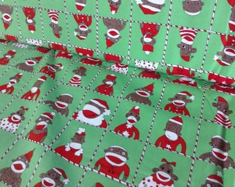 Sale Sock Funky Monkey's  Santas Little Helpers in squares on green back ground by Erin michael for 5 Funky Monkey collection  OOP 1 yard