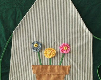 child's full adjustable apron with potted yo yo flowers