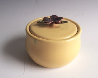 Small lidded jar- yellow with dark red/maroon flower handle