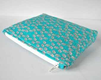 Woman's beauty protective bag floral print padded travel bag cosmetics make up pouch flowers in aqua blue green and white.
