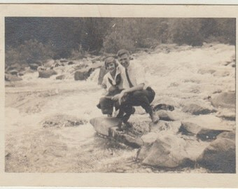 1919 Vintage/Antique photo of a beautiful couple sitting by the ranging river