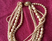 Carolee 6 strand faux pearl necklace with button clasp marked vintage jewelry