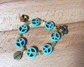 Peace bracelet, Turquoise peace sign beaded bracelet with antique bronze charms, stretchy bracelet, peace sign bracelet, charm bracelet