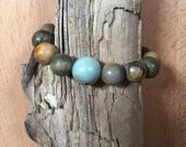 Earth tone Picasso jasper beaded stretch bracelet withlight blue Amazonite focal bead