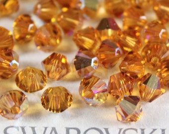 Swarovski Elements Crystal 5328 5301 Xillion Bicone Beads TOPAZ AB - Available in 3mm ,4mm and 6mm