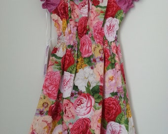 Gorgeous sweet Girls pink floral peasant dress   size 5 and 6 available