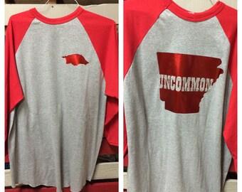 Arkansas Uncommon Raglan Sleeve Baseball Jersey, Razorback Uncommon Shirt, Uncommon Arkansas Baseball style shirt