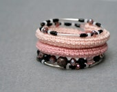 coil crochet bracelet with beads in shades of pale pink