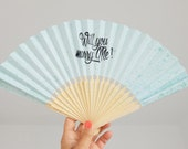 Paper fan with message Will you marry me in Japanese cloth pouch
