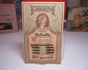 1920's Art Deco unused card of Prim bobbed hair pins graphics of lady with bobbed hair and bird and floral designs