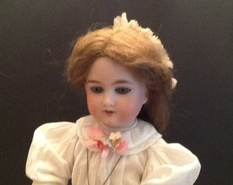 Antique German doll.