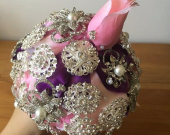 Wedding bridal brooch bouquet with underlying pink and purple rose petals