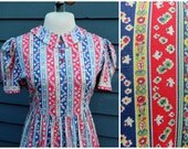 SALE 1930s floral cotton dress . primary color puff sleeves . peter pan collar . day dress frock