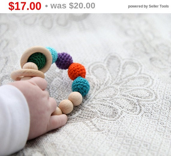 Christmas gift idee Peacock rattle. Teething ring toy with crochet wooden beads. Bright orange, blue, smaragd  green, violet, teal, cyan..