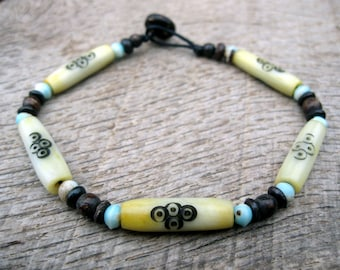 Mens surfer bracelet, bone beads, carved and dyed bone, handmade from earthy natural materials with a toggle and loop clasp, tribal style