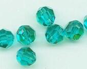Twelve non-standard Swarovski crystals - Art. 5000 - 10 mm - blue zircon AB